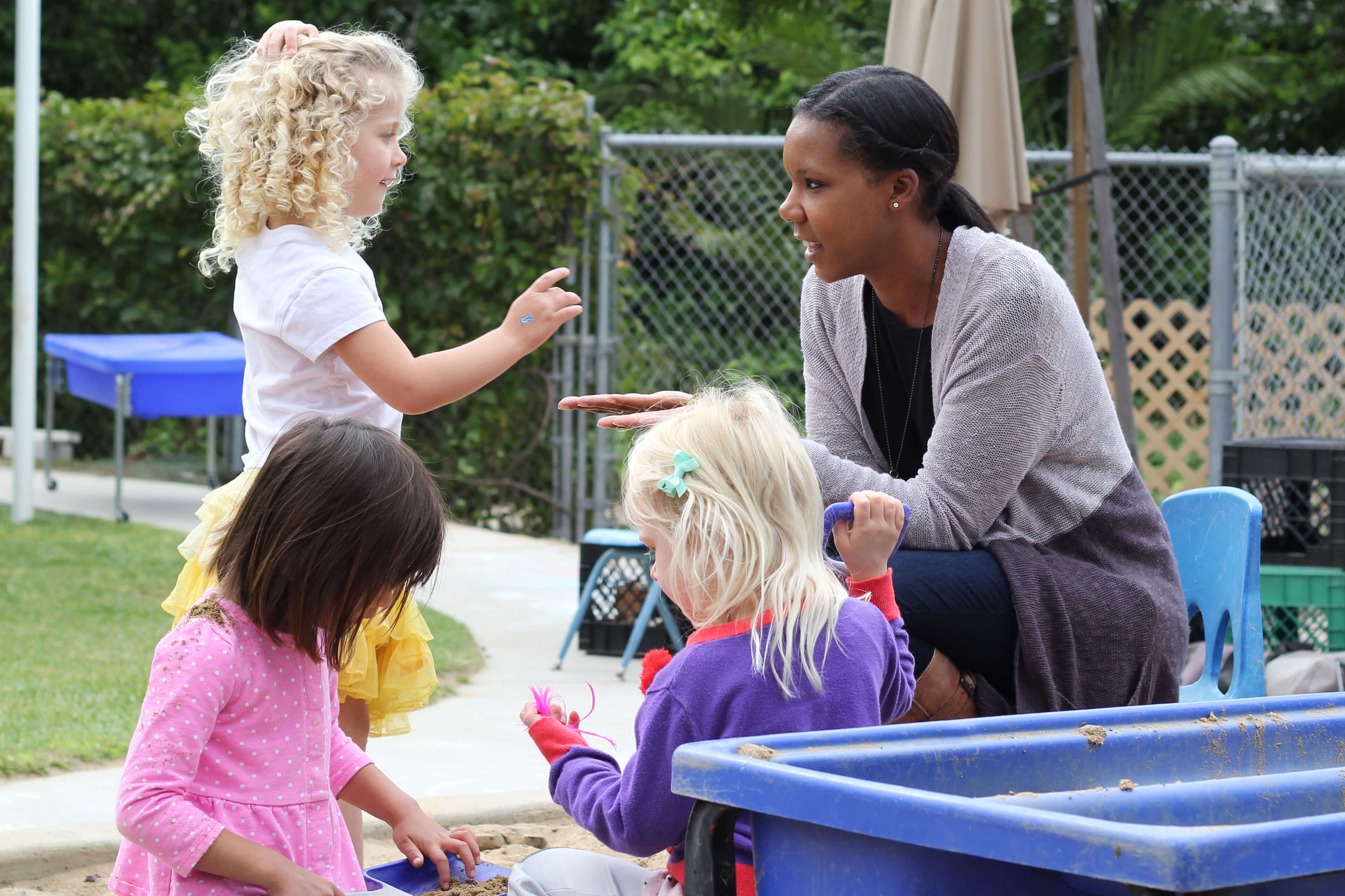 A teacher at the Orfalea Family and ASI Children's Center works with children
