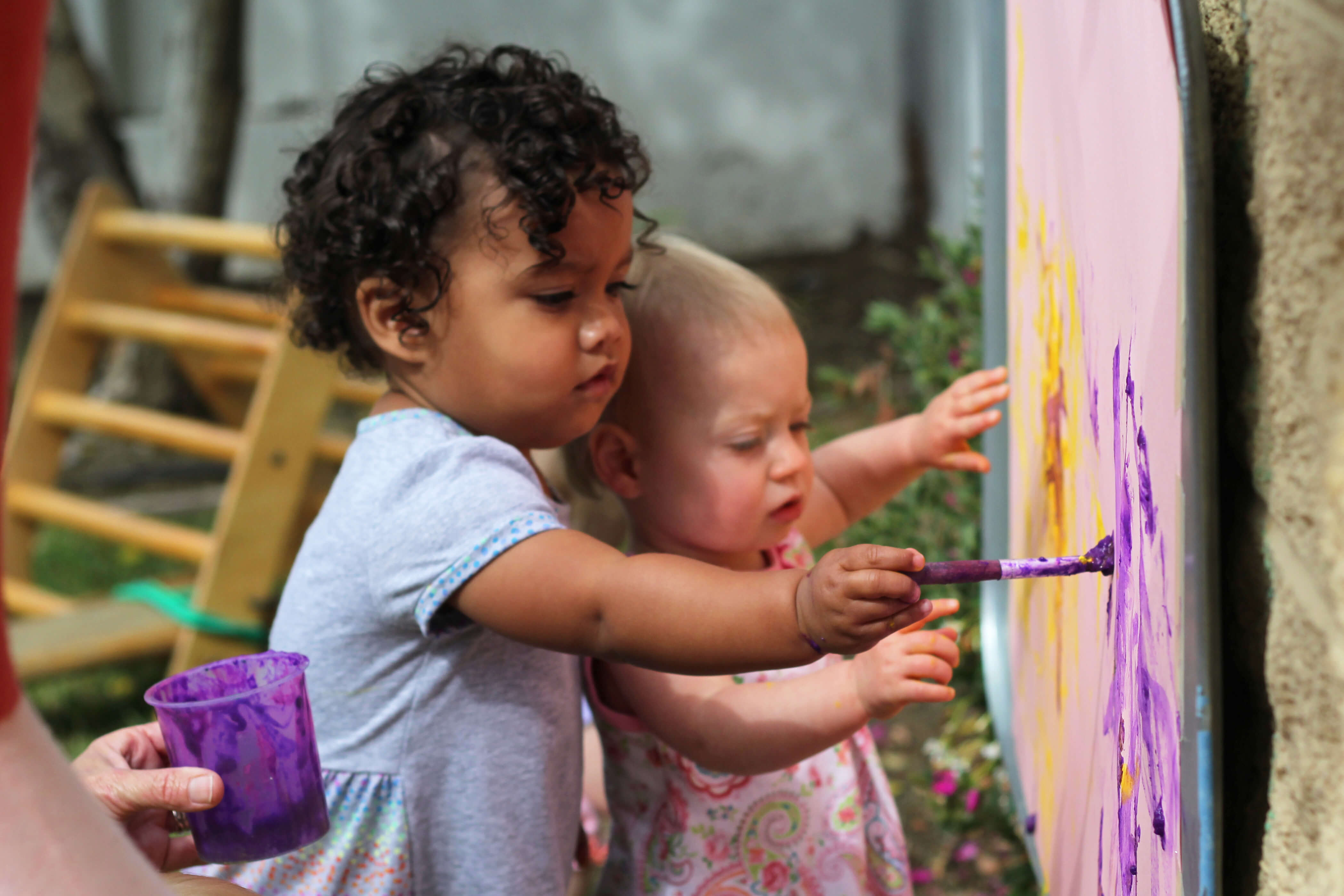 Children painting at the Orfalea Family and ASI Children's Center