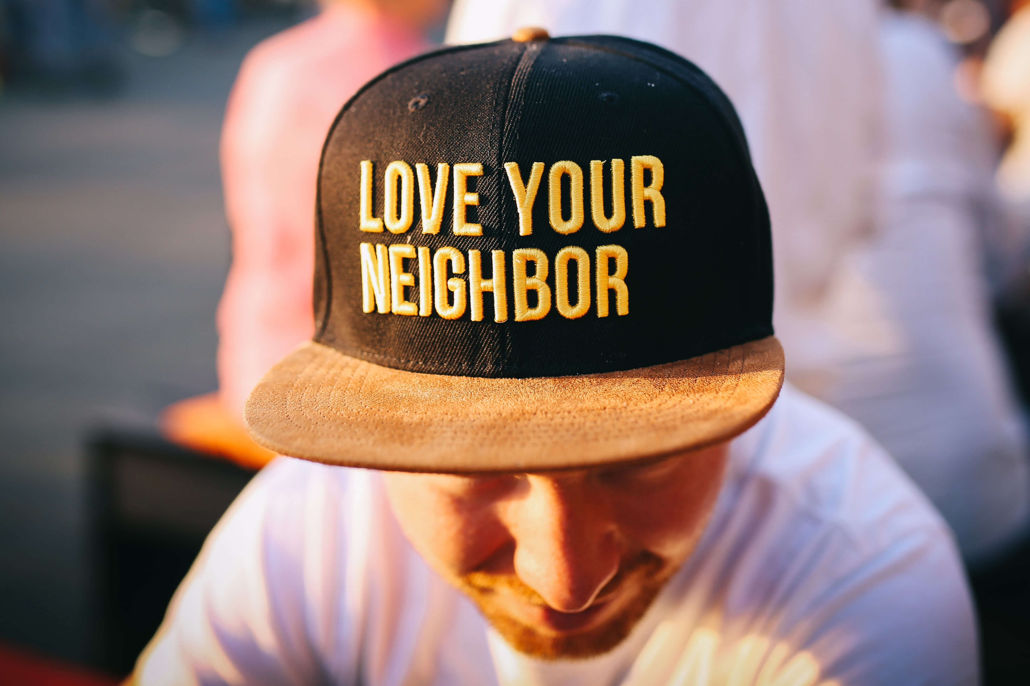 Hat with text that reads love your neighbor