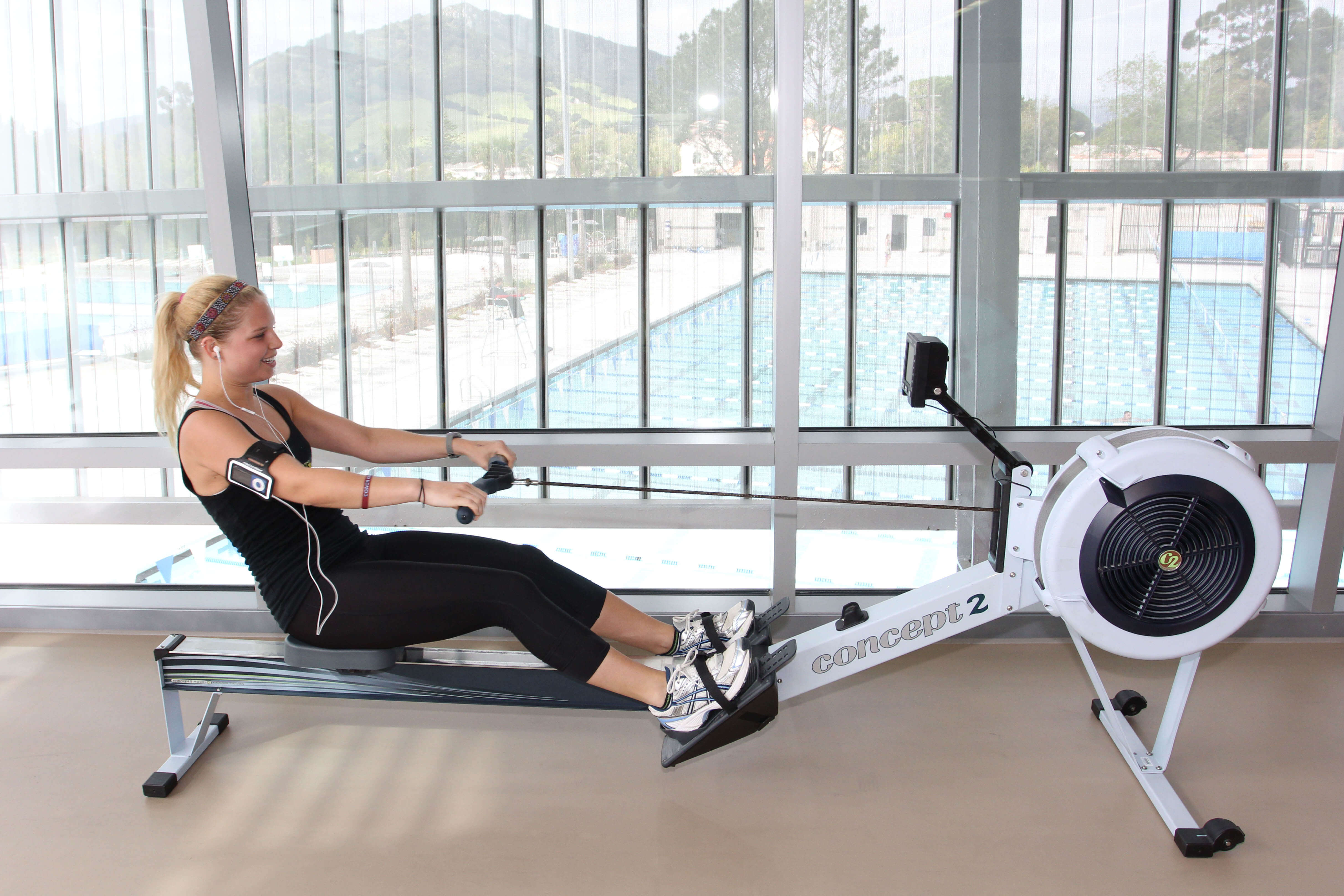 Student using a rowing machine at the Recreation Center