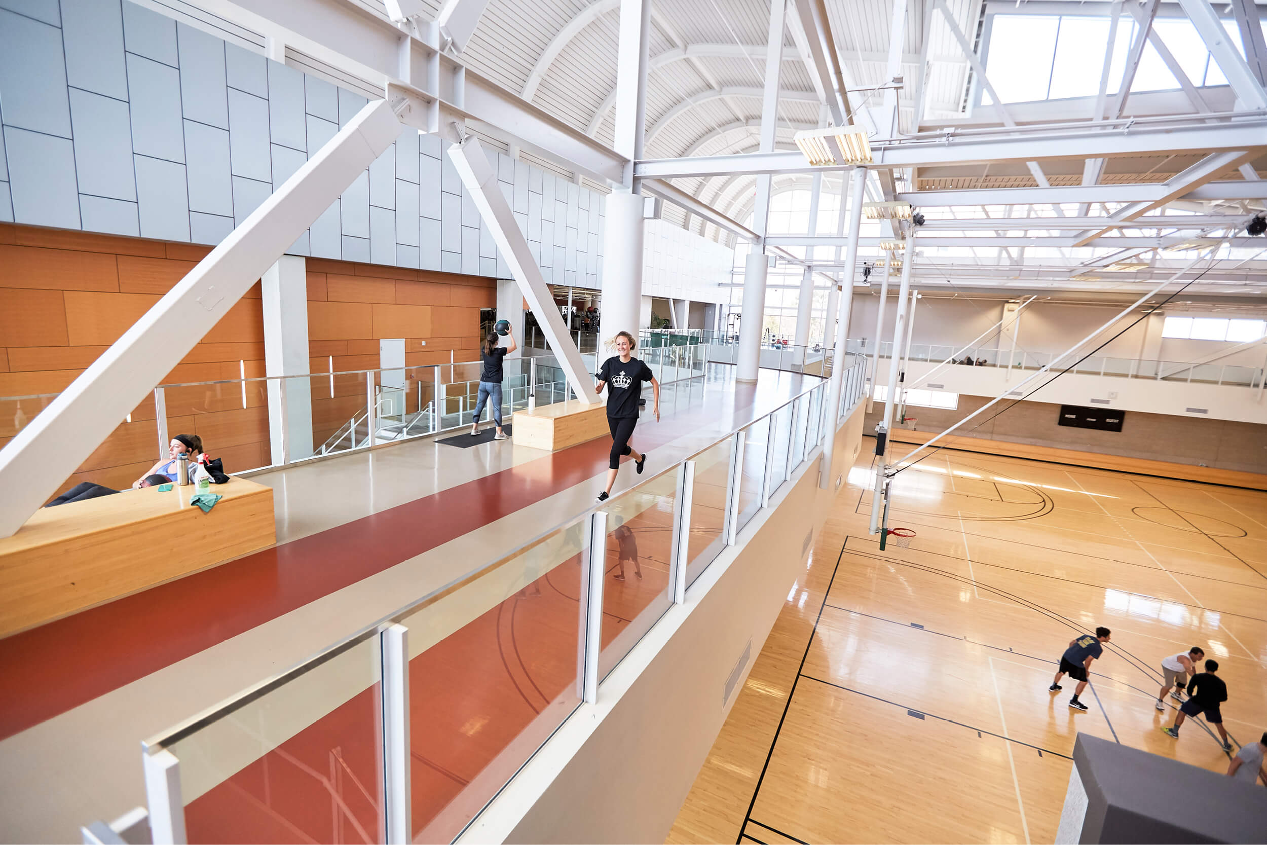 A student runs on the indoor track in the Recreation Center