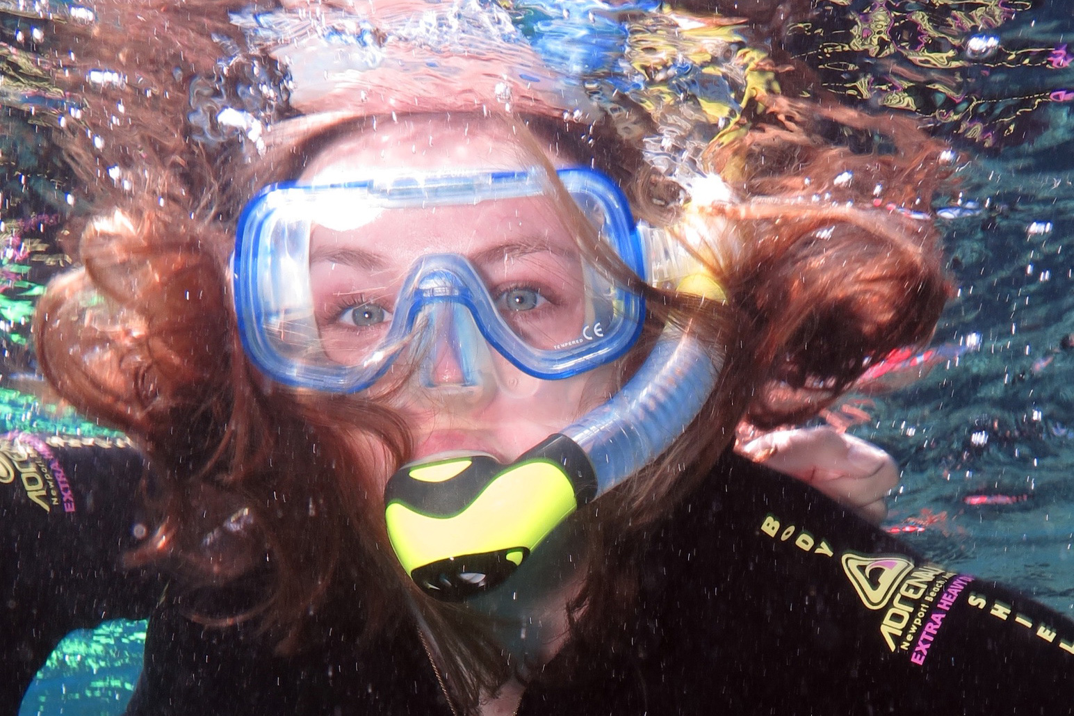 Close up of Kylie Clark snorkeling in the ocean