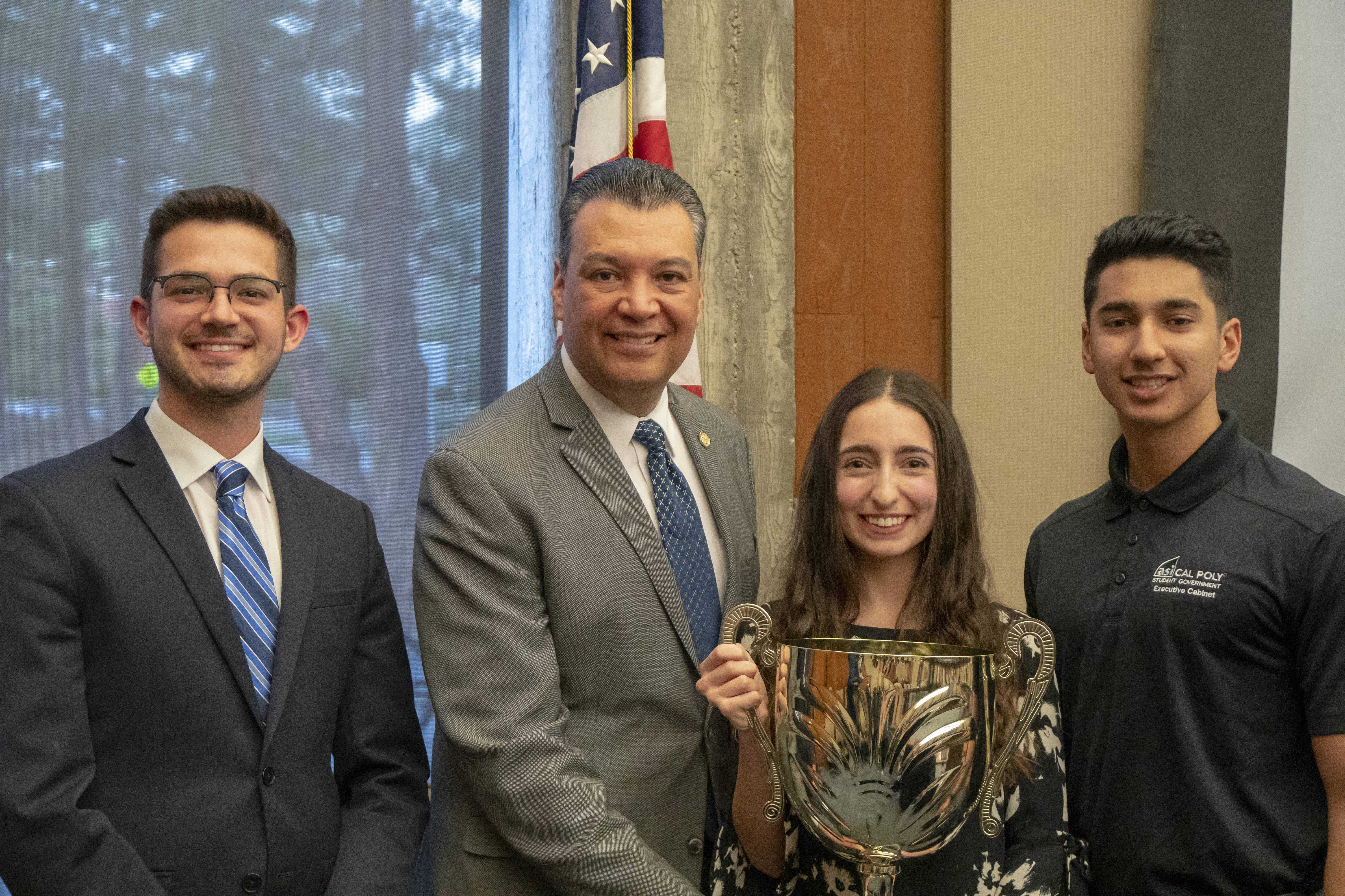 Student Government leaders smile while holding a gold award with California Secretary of State Alex Padilla
