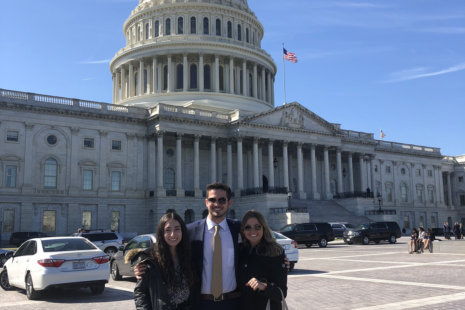 From left to right, ASI President Jasmin Fashami, Chair of the ASI Board of Directors Mark Borges, and Chair of the University Union Advisory Board Danielle Diele in front of the US Capitol building