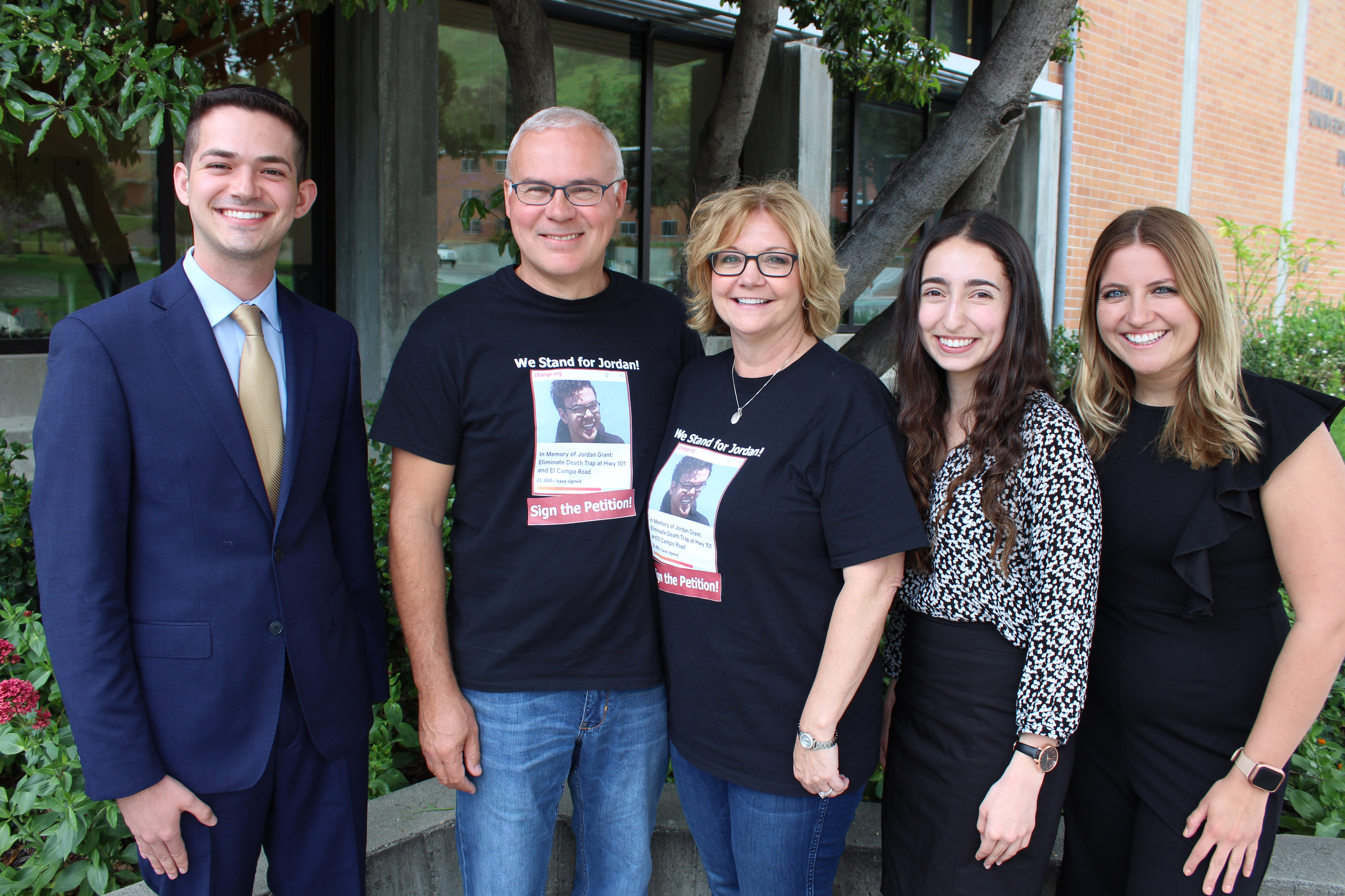 Jordan Grant's parents stand and smile with three Student Government leaders