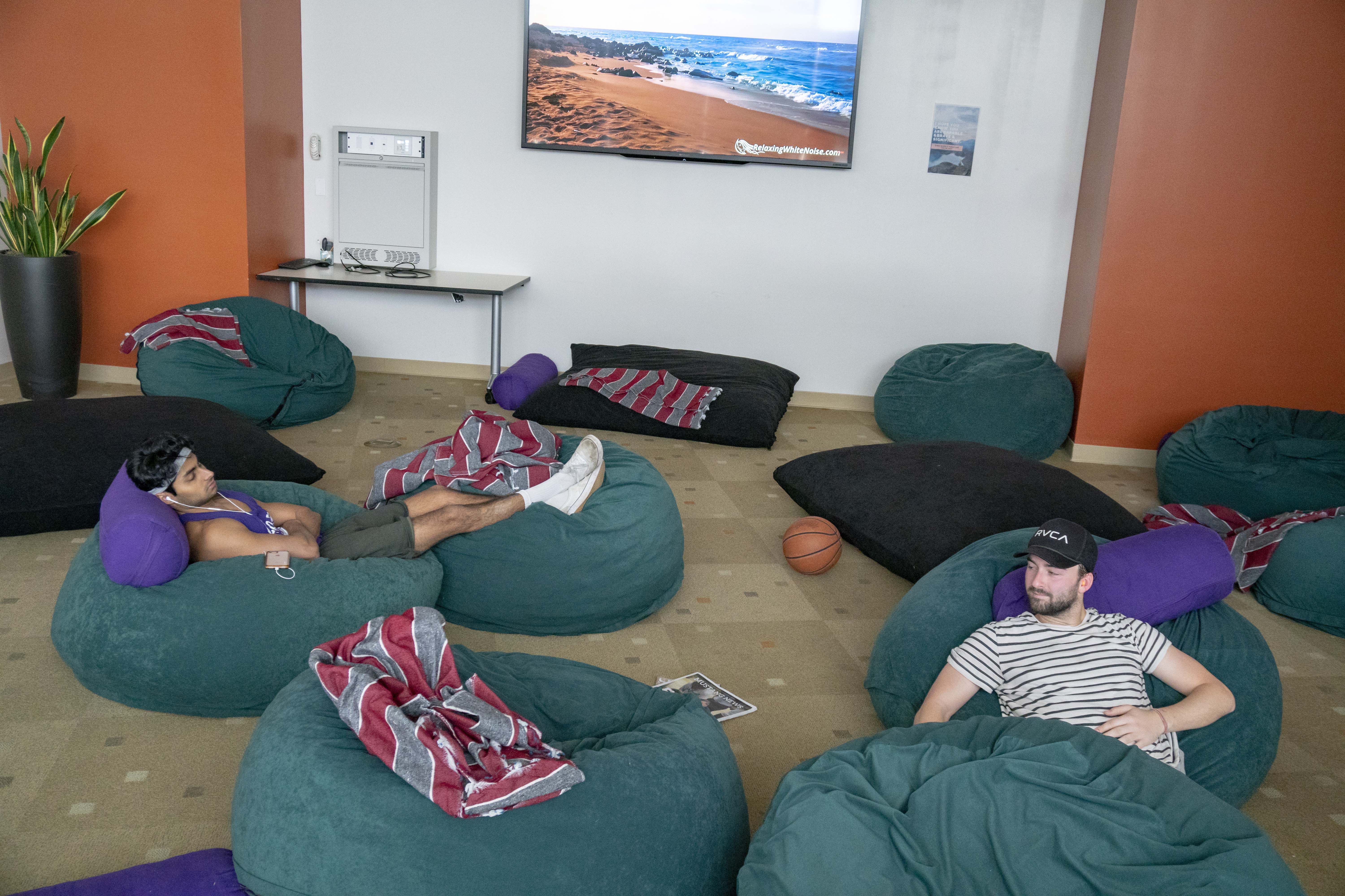 Two students sit in bean bag chairs in the Recreation Center Training Room