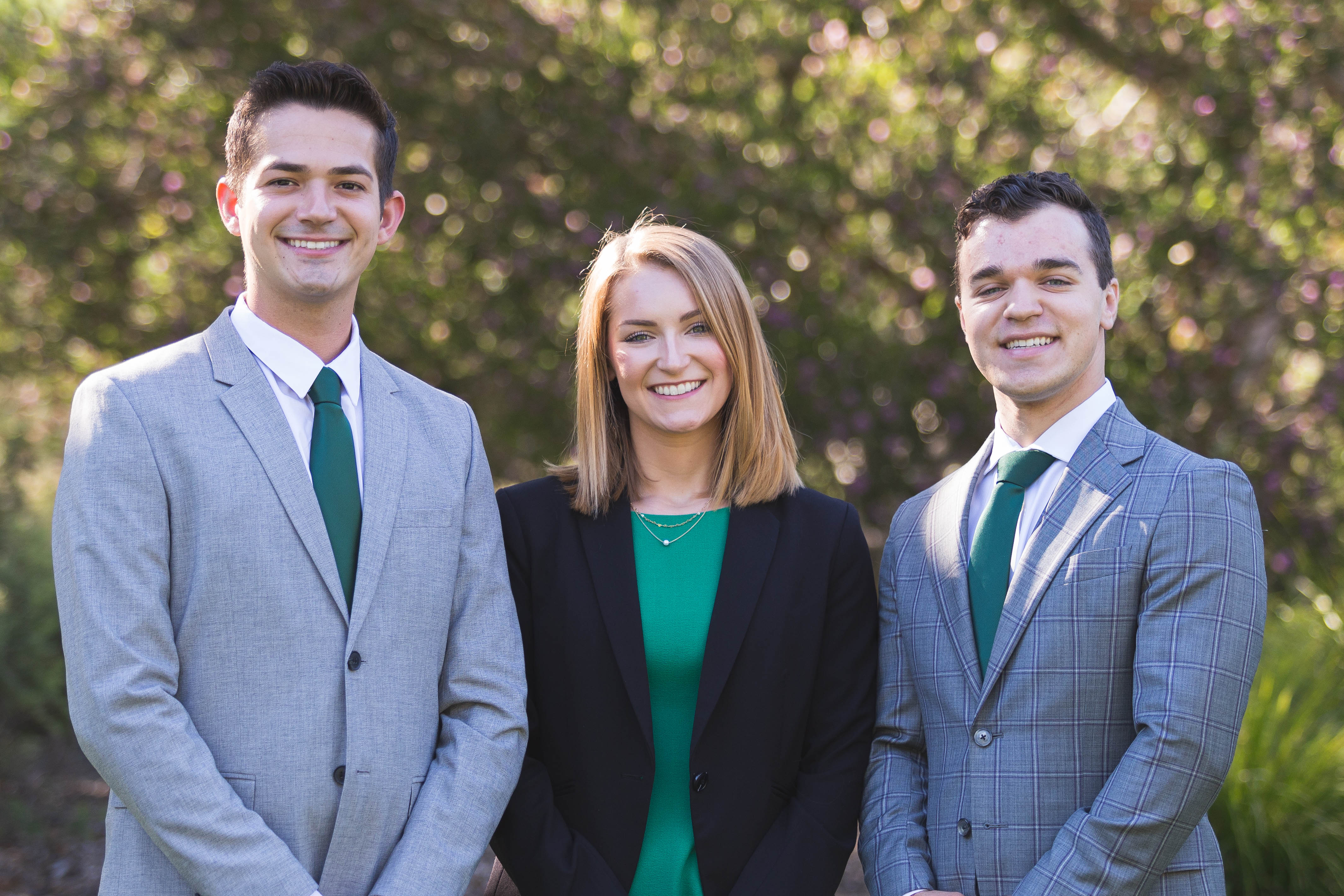 Mark Borges, Elizabeth Roseman, and Rob Moore stand smiling in professional clothing